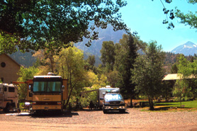 Shaded RV sites along the Uncompahgre River at 4j+1+1 RV Park & Campground in Ouray, Colorado