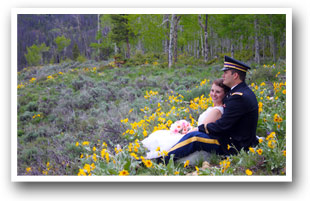 Colorado Wedding couple sitting in a field of wild flowers