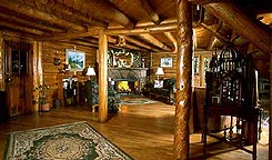 Interior of Allenspark Lodge's Great Room, rustic log furnishings in Allenspark