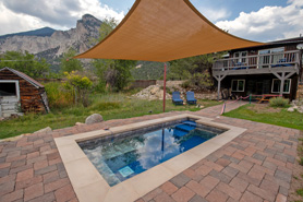 Chalk Cliffs Chalet hot springs pool under a canopy at Antero Hot Springs Cabins in the Buena Vista Area, Colorado