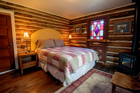 Inside view of Hortense Cabin with queen bed at Antero Hot Springs Cabins in Buena Vista, Colorado