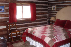 Antero Hot Springs Cabins with Authentic log cabin bedroom in the Buena Vista Area