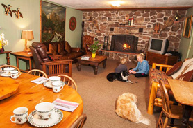 Children and Pet Dogs in Dining room at Avalanche Ranch Cabins and Hot Springs in Crystal River Valley near Glenwood Springs, Aspen, and Snowmass Village, Colorado