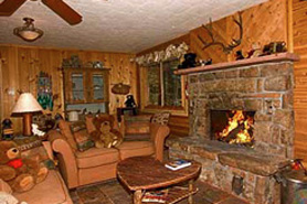 Fire place inside a log mountain cabin at Bear Paw Cabin and Double K Ranch in Estes Park Colorado