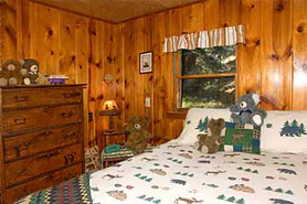 Cozy bedroom at Bear paw cabins and Double K Ranch in Estes Park Colorado