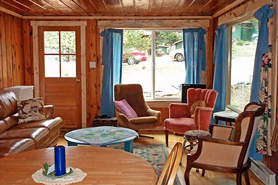 Living area inside a mountain cabin with Bear Paw Cabin and Double K Ranch in Estes Park, Colorado
