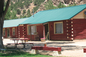 The front of a real log cabin at Bighorn Park in Coaldale, Colorado