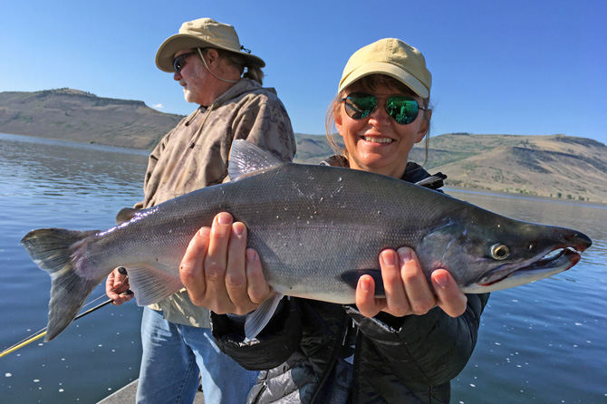 Two people showing of their catch of fish with Blue Mesa Fishing in Gunnison, Colorado