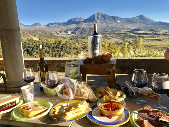 Delicious farm-to-table meal served on patio with a beautiful scenic mountain view at Bross Hotel Historic Bed & Breakfast Lodging in Paonia, Colorado