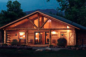 Night time shot of a cabin at Cabins at Hartland Ranch in the Pagosa Springs area