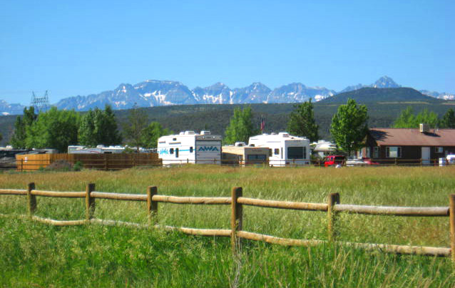 RV campers in front of San Juan Mountains near Montrose, Colorado