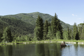 Canoe in out Private pond at Chair Mountain Ranch Cabins near Crystal River Valley in Colorado