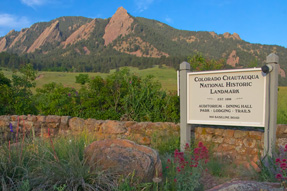 Flatirons behind Chautauqua sign at Chautauqua in Boulder, Colorado. Front door access to 40 miles of hiking trails.