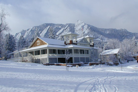 Dining commons in snow with mountains behind in Boulder Colorado. On-site dining featuring organic colorado cuisine.