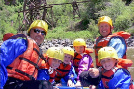 Family having fun white water rafting with Clear Creek Rafting Company near Idaho Springs, Colorado