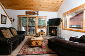 These Estes Park Condos have living rooms with cozy fireplaces