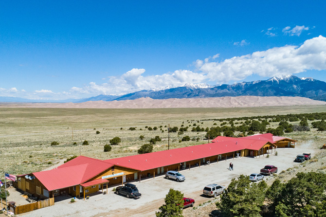 Top of a sand dune at Great Sand Dunes National Park near Alamosa, Colorado. Newly Remodeled Deluxe Lodge Rooms. More Privacy. King BED. Poach Views of Great Sand Dunes National Park.