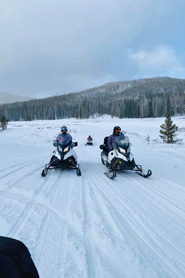 Snowmobilers riding near Hot Sulphur Springs, Colorado