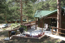 Mountain cabin with large deck at Machin's Cottages in Estes Park, Colorado