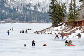 Ice fishing and sledding on Vallecito Lake in Durango, Colorado