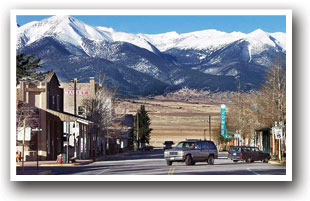 Main Street in Westcliffe, Colorado with mountains in the background