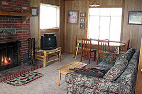 Relax by the fire at Melody Lodge Cabins, The Colorado Vacation Directory