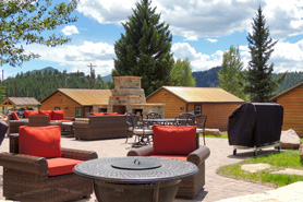 Beautiful outdoor patio area at Mountain River Lodge Luxury Cabin Rentals in Lake George, Colorado