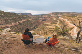 Couple enjoying view of the Uncompahgre Plateau's Redrock Canyons in Naturia, Colorado