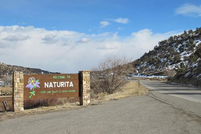 Naturita welcome sign along highway in Colorado