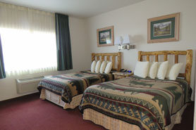 Beds at North Park Inn and Suites near Walden, Colorado