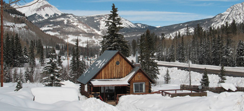 The Nugget Cabin covered in a blanket of snow near Durango, Colorado