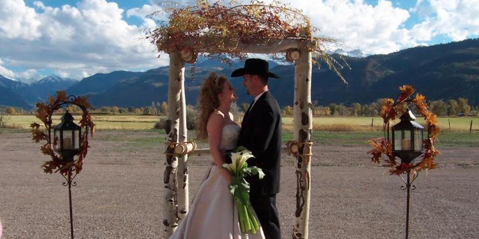 Couple getting married at the Ouray Country 4-h Event Center in Colorado with mountains in the background