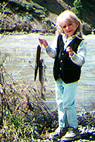 Girl with fish at Pagosa Riverside Campground, Colorado