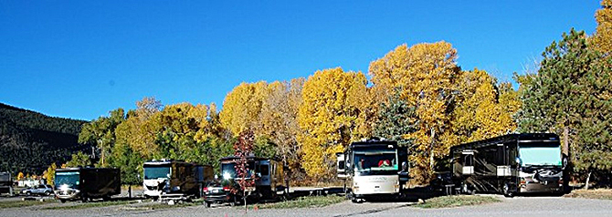 RVs lined up at the Peacock Meadows Riverside RV Park and Campground in the South Fork Area, Colorado