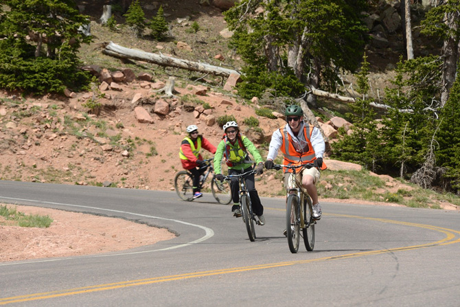 Bikers going down Pikes Peak with Pikes Peak Mountain Bike Tours near Colorado Springs, Colorado