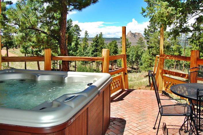 Hot tub on deck at the Angler Cove Cabin at the Pikes Peak Resort in the Pikes Peak area of Colorado