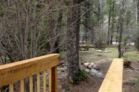Bridge to tent site at Archer's Poudre River Resort in the Poudre River Valley near Fort Collins, Colorado