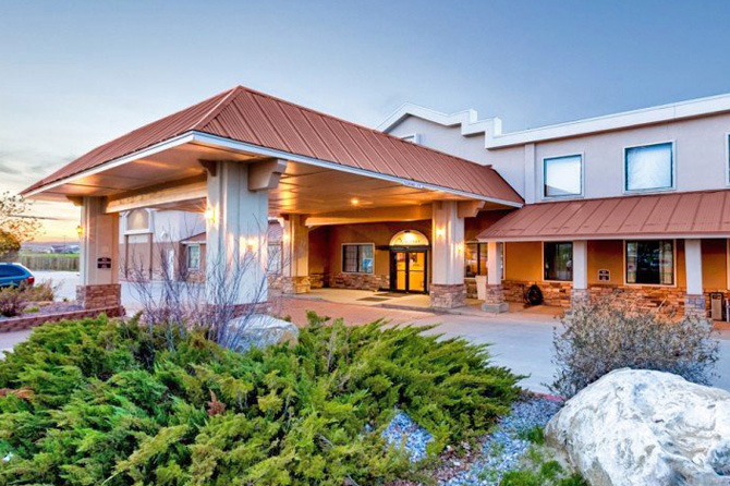 The front of the inn at Clarion Inn and Suites of Craig in Craig, CO. Beginning Family Friendly -- Kitchenette Suites -- Full-Service Quality Inn -- AMENITIES: Indoor Pool, Pool Table, Restaurant, WiFi, Continental Breakfast.