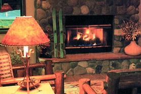 A cozy fireplace at Ridgway - Ouray Lodge & Suites in Ouray Colorado