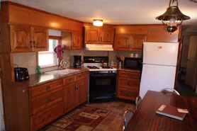 A kitchen at Riverbend Resort Cabins and RV Park in the South Fork Area of Colorado
