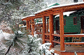 Snow falls on Riverbend Resort Cabins in the South Fork Area, Colorado