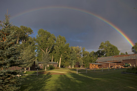 A rainbow over Rockey River Resort, in Gunnison, Colorado