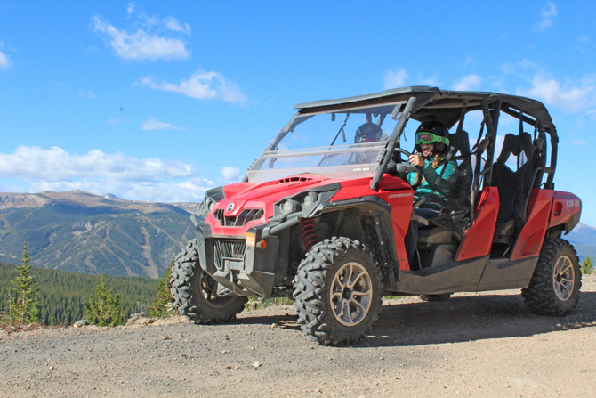 Two people in ATV rented from Rocky Mountain Adventures, Colorado