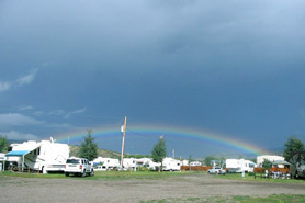 Rainbow over RV campers at South Fork Lodge, Cabins & RV Park in the South Fork area of Colorado