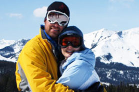 Couple hugging at wolf creek ski resort, close to South Fork Lodge, Cabins & RV Park