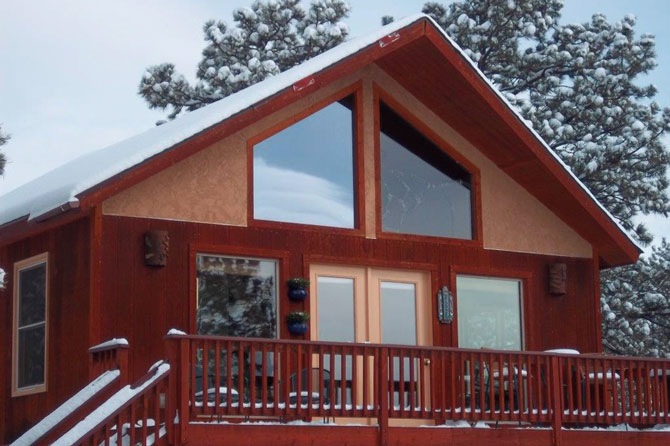 Spa Sola Fide Cabin with a coat of snow ontop in Westcliffe Colorado, A Cabin for two