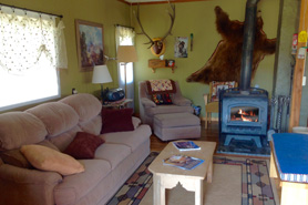 Warm and cozy interior of Stewart Homestead Cabin