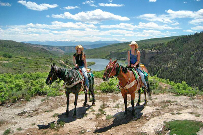 AJ Brink Outfitters riders on horses on trail ride near Sweetwater, Vail, and Glenwood Springs, Colorado