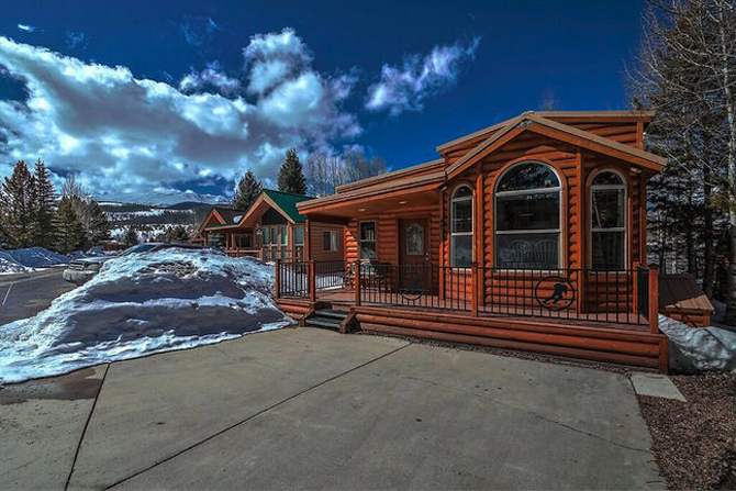 A cabin covered in snow at the Tiger Run Resort: Chalets & RV Park in Summit County Colorado