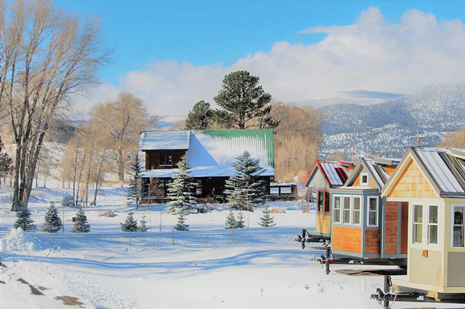 A row of cabins in the snow with Tiny Timbers Resort in South Fork, Colorado. Start a family tradition at Tiny Timbers Resort. Vacation simply with small Cabins and covered decks, surrounded by National Forest.